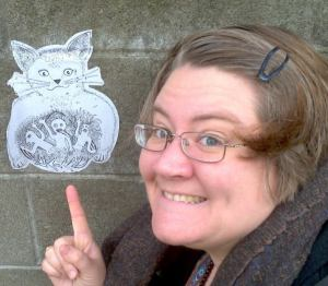 Photo of Frances Donovan (Okelle) pointing at a cat