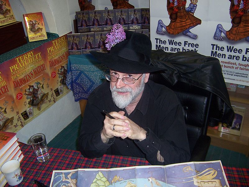 Photograph of author Terry Pratchett at a book signing, courtesy of Myrmi via Wikimedia Commons